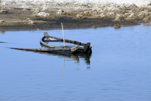 A sinking rowboat
